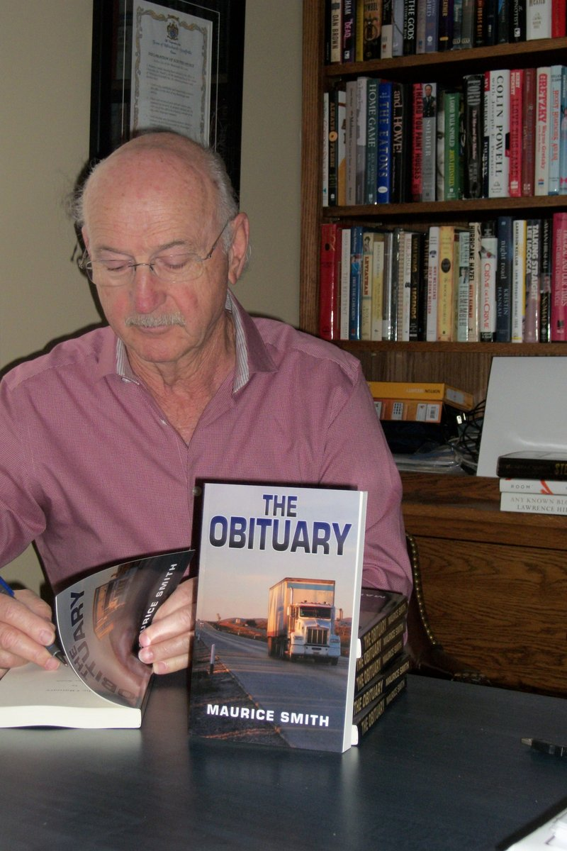 Maurice signs copies of his debut fiction novel - The Obituary. Check it out at www.mauricesmithmysteries.com.